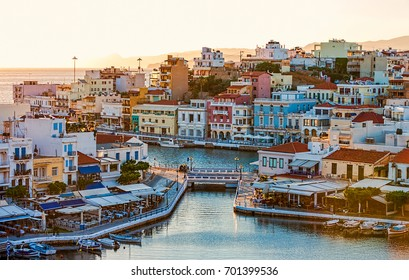 Agios Nikolaos in the early morning, Crete, Greece. Agios Nikolaos is a picturesque town in the eastern part of the island Crete built on the northwest side of the peaceful bay of Mirabello.