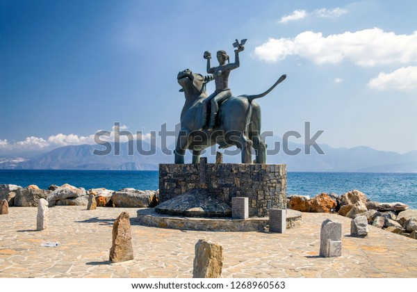 Agios Nikolaos / Greece - September 27, 2018: The statue of Europe is sitting on a bull. Sculpture of Europe, mother of King Minos, riding a bull in Agios Nikolaos, Crete, Greece.