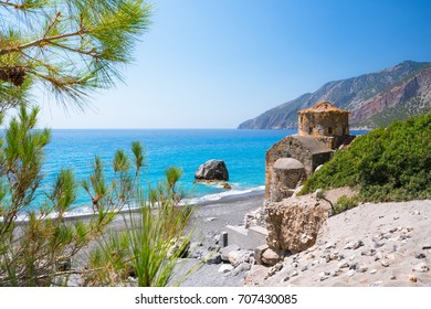 Agios Pavlos beach with Saint Paul church, a very old Byzantine church that was built at the place Selouda, an incredible beach at Opiso Egiali area.