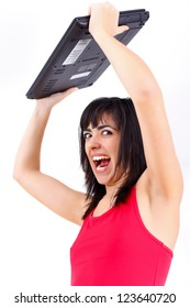 Agitated woman with laptop.