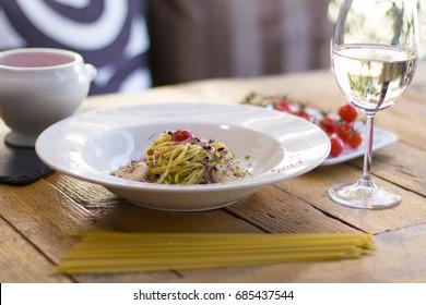 Aglio e olio with shrimps and strawberry soup with mascarpone