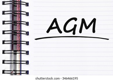 AGM words on spring white note book.