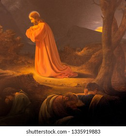 Agony in the Garden of Gethsemane. Jesus is praying and the apostles Peter, John and James are sleeping, An old altarpiece from 1839 by D. C. Blunck in Frederiksund church, Denmark, March 10, 2019
