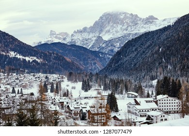 Agordo city in winter season. Mountains covered in snow on background. Belluno, Italy