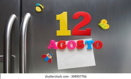 Agosto 12 (August 12 in Spanish language) calendar date made with plastic magnetic letters holding a note of graph paper on door refrigerator. Spanish version