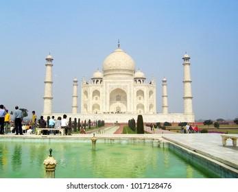 AGRA, INDIA - 18 FEBRUARY 2008: Tourists visiting the Taj Mahal, designated as a UNESCO World Heritage Site in Agra, India.