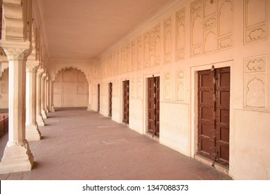 AGRA, INDIA - 23 MARCH, 2019: Ancient, old doors and architectural details of wall and pillars (colonnade walkway) in Red Fort, Agra.  The Agra Fort plays a key role in the Sherlock Holmes mystery.