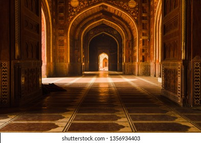 AGRA, INDIA - 5 MAY 2015: Decorated corridors and hallways in the Taj Mahal main mosque, Agra, India.