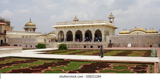 AGRA, INDIA - APRIL 12, 2015. Indian people visit Agra Fort, World Heritage site. The fort was built by the Mughals, can be more accurately described as a walled city in Agra, India.