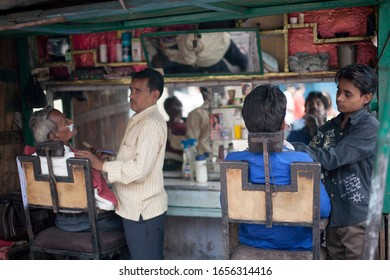AGRA, INDIA - APRIL 12: Unidentified Barber man working in urban barber shop at the main street in Agra on Apr 12, 2014