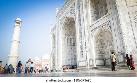 Agra / India - April 14 2017: Taj Mahal front facade close up view with a minaret and mosque inside Taj Mahal complex in Agra, India.