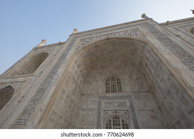Agra India Asia - November 11 2014 - The Taj Mahal (meaning Crown of the Palace) is an ivory-white marble mausoleum on the south bank of the Yamuna river in the Indian city of Agra