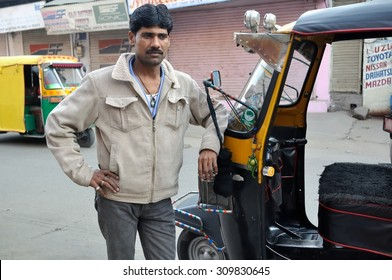 AGRA , INDIA - DECEMBER 27 : Undefined driven take a photo with our auto rickshaw at Agra in the northern state of Uttar Pradesh on December 27,2010 in Agra, India.