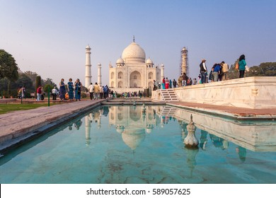Agra, India - February 13, 2017:The Taj Mahal is an ivory-white marble mausoleum on the south bank of the Yamuna river in the Indian city of Agra.