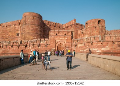 AGRA, INDIA - FEBRUARY 5, 2011: Entrance gate to Agra Fort, which was completed in 1573 and served as the main residence of the Mughal dynasty until 1638. It is a UNESCO World Heritage site.