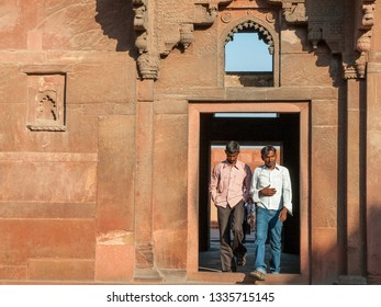 AGRA, INDIA - FEBRUARY 5, 2011: Tourists at Agra Fort, which was completed in 1573 and served as the main residence of the Mughal dynasty until 1638. It is a UNESCO World Heritage site.