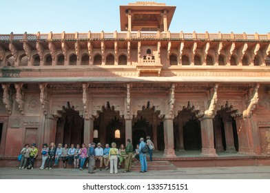 AGRA, INDIA - FEBRUARY 5, 2011: Group of tourists at Agra Fort, which was completed in 1573 and served as the main residence of the Mughal dynasty until 1638. It is a UNESCO World Heritage site.
