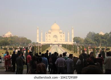 Agra, India - January 13 , 2018 : Tourist Posting in front of Taj at Taj Mahal Agra India.