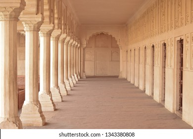 AGRA, INDIA - JANUARY 18, 2019: Architectural details of colonnade walkway in Red Fort, Agra. The Agra Fort plays a key role in the Sherlock Holmes mystery.