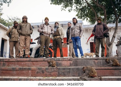 AGRA, INDIA - JANUARY 8, 2015: Indian men with weapon and monkeys on January 8, 2015 in Agra, India
