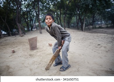 AGRA, INDIA - JANUARY 8, 2015: Little Indian boy playing game on January 8, 2015 in Agra, India