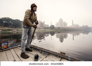 AGRA, INDIA - JANUARY 8, 2015: Man with Taj Mahal Palace on background on January 8, 2015 in Agra, India