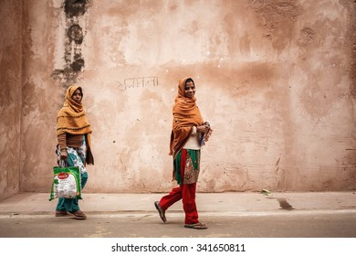 AGRA, INDIA - JANUARY 8, 2015: Two young Indian women on the street on January 8, 2015 in Agra, India