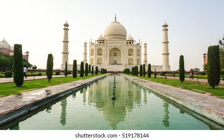 Agra, India - Jul 13, 2015. Taj Mahal with the garden at sunny day in Agra, India. It is one of the worlds most celebrated structures and a symbol of Indias rich history.