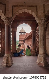 Agra, India - July 07 2017: A Couple Enjoying Afternoon Atmosphere at Agra Fort