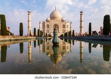 Agra, India - Mar 7, 2015: Walkways beside reflecting pool. Taj Mahal from Main Entrance