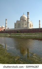 AGRA, INDIA - MARCH 05, 2006: Taj Mahal building and reflection in the river Yamuna