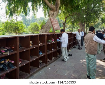 Agra, India - March 11, 2018:  Tourists visiting the Taj Mahal have to deposit their shoes before entering the the ivory-white marble mausoleum.