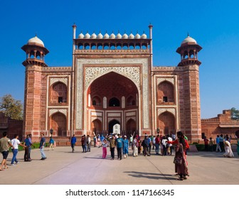 Agra, India - March 11, 2018:  Tourists gathering at the entrance gate of the Taj Mahal, the ivory-white marble mausoleum in the city of Agra, Uttar Pradesh, India.
