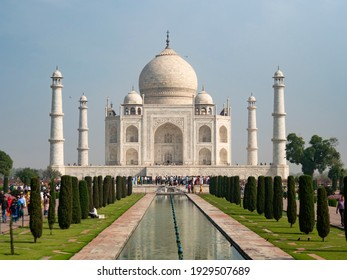 AGRA, INDIA - MARCH, 26, 2019: the taj mahal and fountain as viewed from the main entrance in agra, india on a spring morning