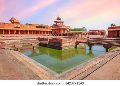 Agra, India, May 29,2019: Fatehpur Sikri medieval fort city built in the year 1570 at Agra, India. View of Anup Talao a concert stage surrounded by water with view of ancient architecture at sunset