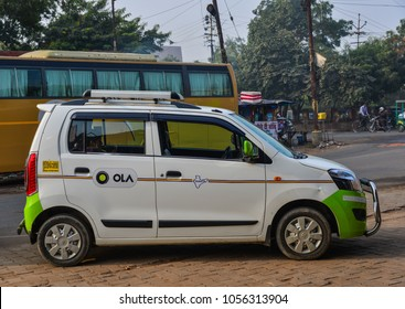 Agra, India - Nov 12, 2017. Ola car on street in Agra, India. Agra is included on the Golden Triangle tourist circuit, along with Delhi and Jaipur.