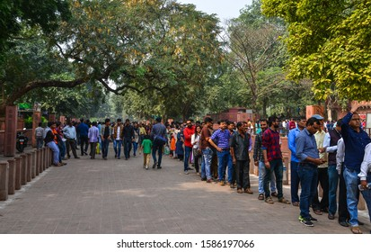 Agra, India - Nov 12, 2017. Local people stand in line to get inside Taj Mahal in Agra, India. Over 4 million local people visit the Taj Mahal every year.