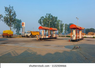 AGRA, INDIA - NOV 15, 2010: petrol station in early morning light on the Highway between Delhi and Agra near Agra, India. AGRA - DELHI Highway reduces time to 5 hours.
