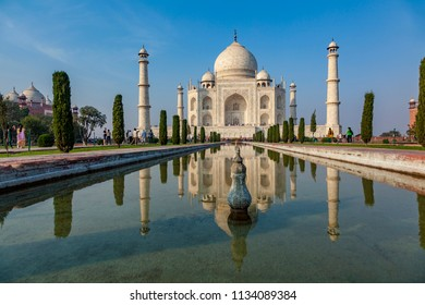 AGRA, INDIA - NOV 15, 2011: Taj Mahal in India under clear blue sky. It is the most beautiful building in the world.