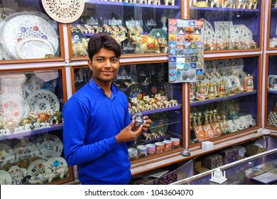 AGRA, INDIA - NOVEMBER 10: Unidentified man works in a souvenir shop in Taj Ganj neighborhood on November 10, 2014 in Agra, India. Agra is one of the most populous cities in Uttar Pradesh