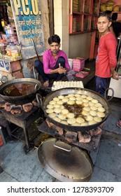 AGRA, INDIA - November 24, 2018: Man making Indian street food in Agra.