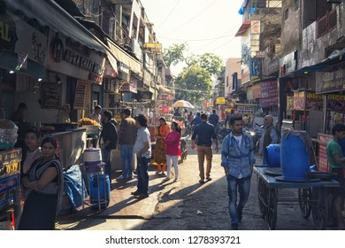 AGRA, INDIA - November 24, 2018: Busy street food market with people walking by.