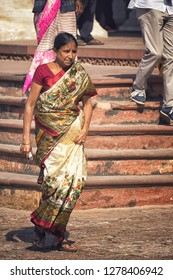 AGRA, INDIA - November 24, 2018: Woman wearing traditional indian dress in Red Fort, Agra.