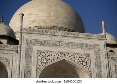 """AGRA, INDIA - November 24, 2018: Details of Taj Mahal and dome, Agra, India. Text in arabic says """"O soul, you are at rest. Return to the Lord in peace with him, and he at peace with you"""""""