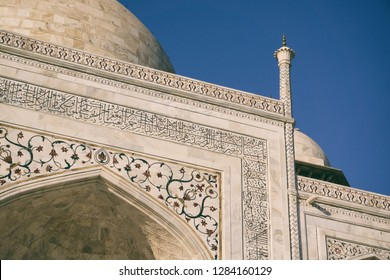 """AGRA, INDIA - November 24, 2018: Details of the Taj Mahal and tower, Agra, India. Text in arabic says """"O soul, you are at rest. Return to the Lord in peace with him, and he at peace with you"""""""