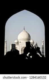 AGRA, INDIA - November 24, 2018: Shadows of people taking photos with their phones of the Taj Mahal, Agra, India.