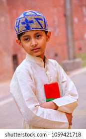AGRA, INDIA - NOVEMBER 8: Unidentified boy stands near the wall of Taj Mahal complex on November 8, 2014 in Agra, India. Agra is one of the most populous cities in Uttar Pradesh