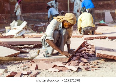 AGRA, INDIA - OCT 17: worker prepares sandstones for renovation of the Red Fort on October 17,2012 in Agra, India. The fort was mentioned for the first time in 1080 AD when a Ghaznavide captured it.