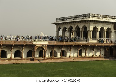 AGRA, INDIA - OCTOBER 24: Tourists and view Taj Mahal from the ramparts of Agra Fort on October 24, 2012 in Agra. Both Agra Fort and Taj Mahal are UNESCO World Heritage sites.