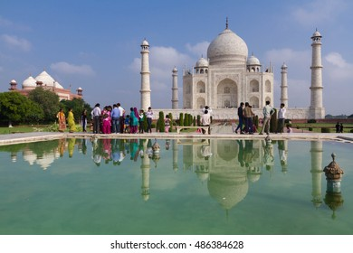 AGRA, INDIA - OCTOBER 7, 2013: Taj Mahal with reflection in water. It is one of the famous Indian landmark and tourist attraction.